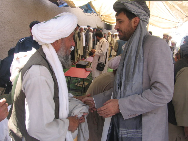 Oxfam says people are the best resources for local peace-building. Here the governor of Kandahar Province greets a local elder.