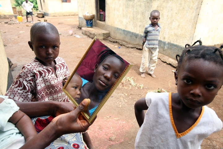 A displaced woman and children in Grafton, an internally displaced peoples camp (IDP) 30 km from Free Town, capital city of Sierra Leone February 2008. Thousands of people were displaced during the 1995 – 2002 civil war.