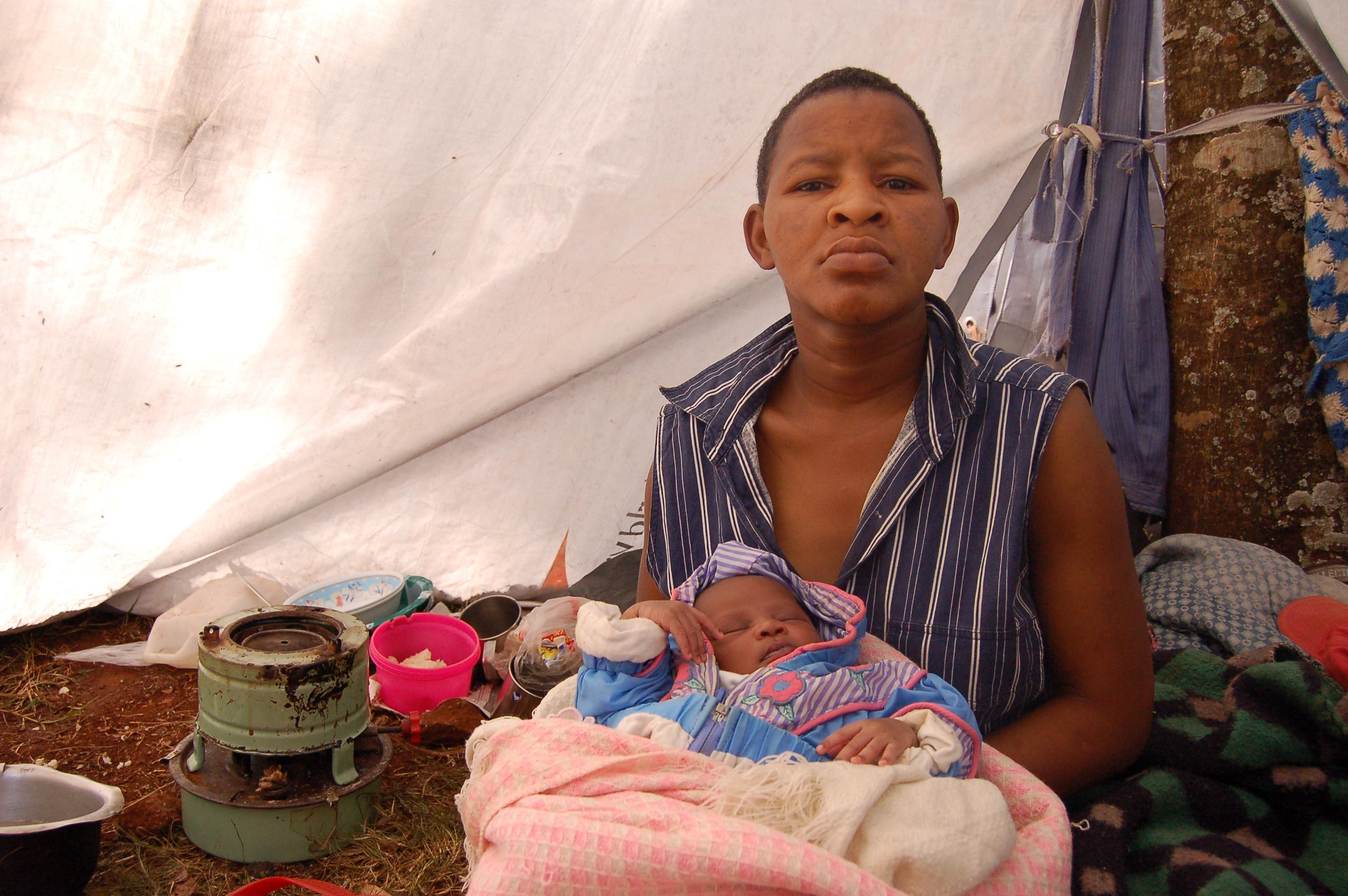 First-time mother Elizabeth Mueni gave birth under a tree on a roadside, she is one of 263 internally displaced persons (IDPs) camping at the Dagoretti district officer's compound, Kenya. March 2008.