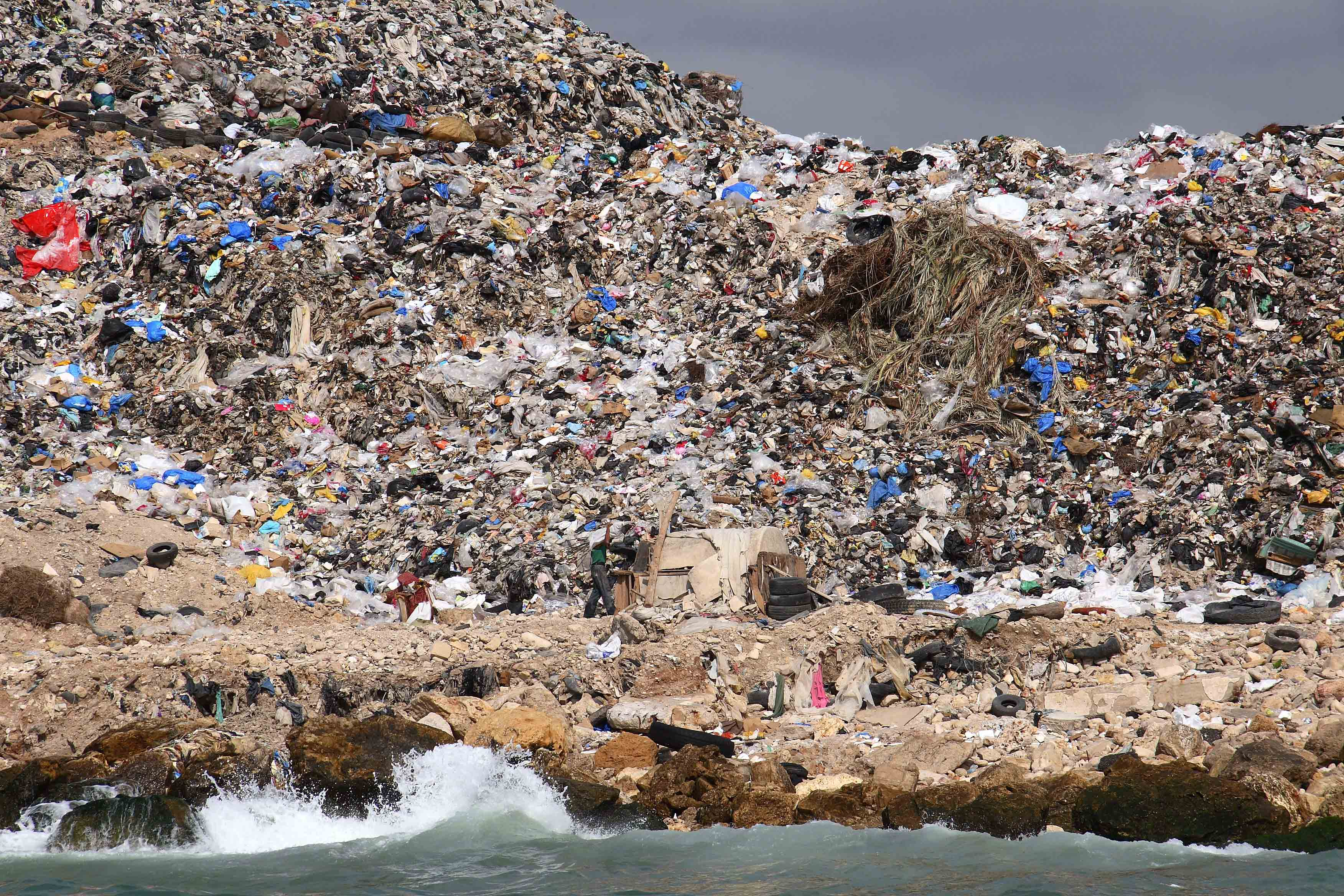 Established in 1975 as a temporary municipal tip, the tip on the edge of Sidon has grown into a four-storey high, 600,000 cubic meters mountain of garbage, soil, concrete debris, hospital waste and occasional dead animals.