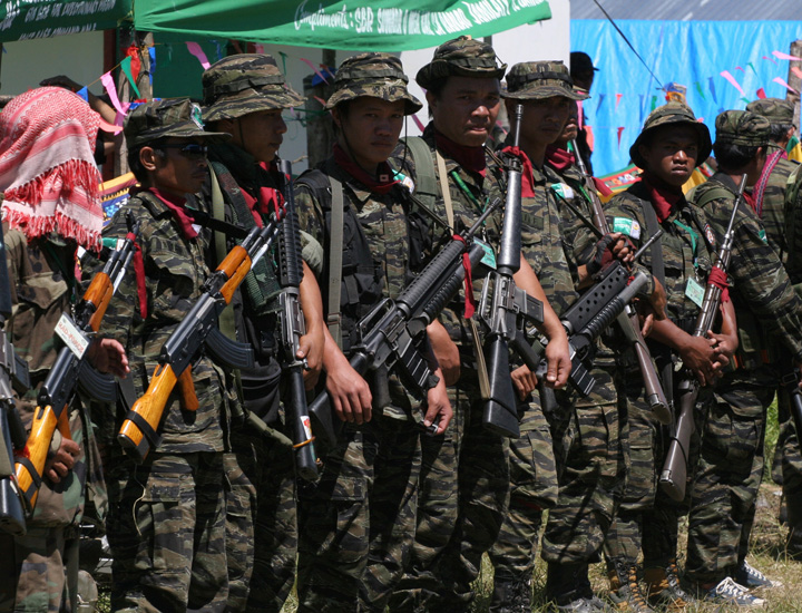 Moro Islamic Liberation Front (MILF) guerrillas during a gathering in the group's Camp Bushra, Mindanao island, Philippines March 2008. The Philippine government's 35-year confrontation with Muslim separatists and a second conflict with communist insurge