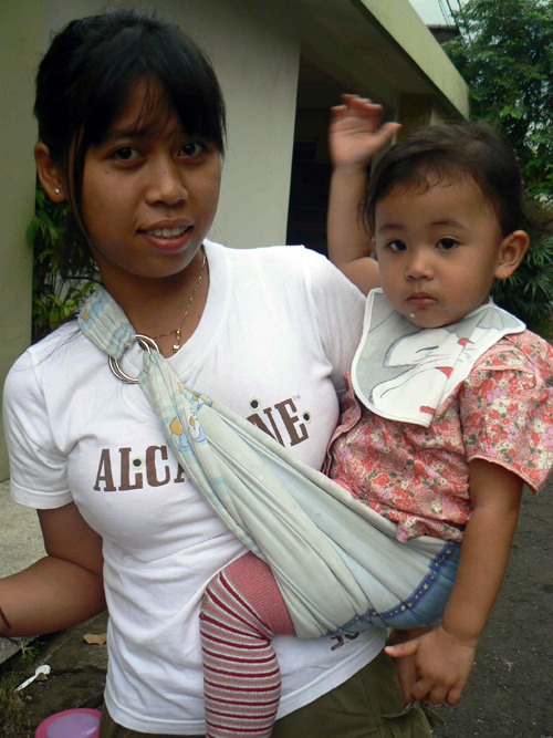 Two-year-old Kayla and his carer in Jakarta. The Indonesian government is trying to encourage mothers to breast feed their babies.