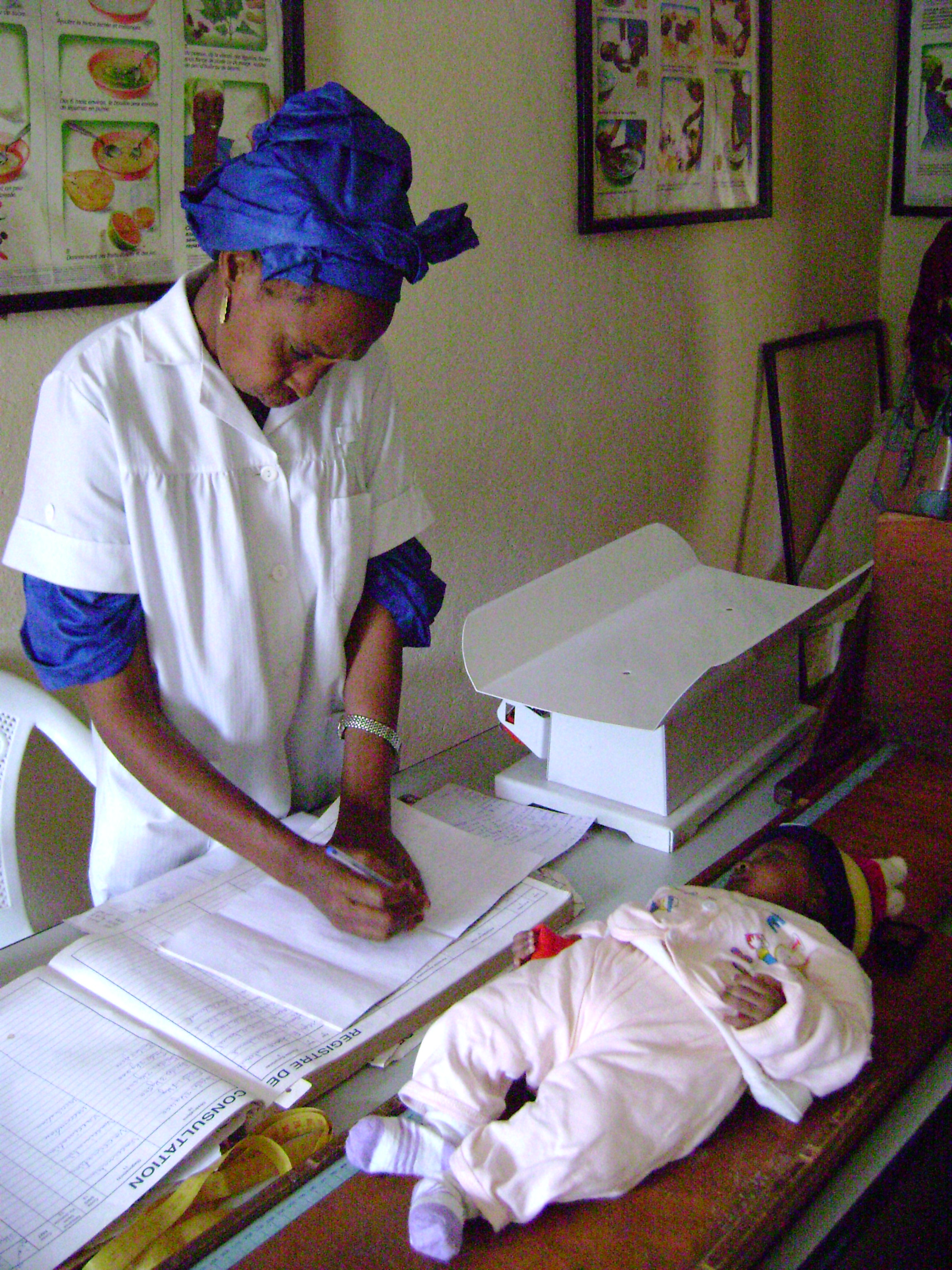 Baby-weighings at a health clinic in Labé, Guinea. October 2007.