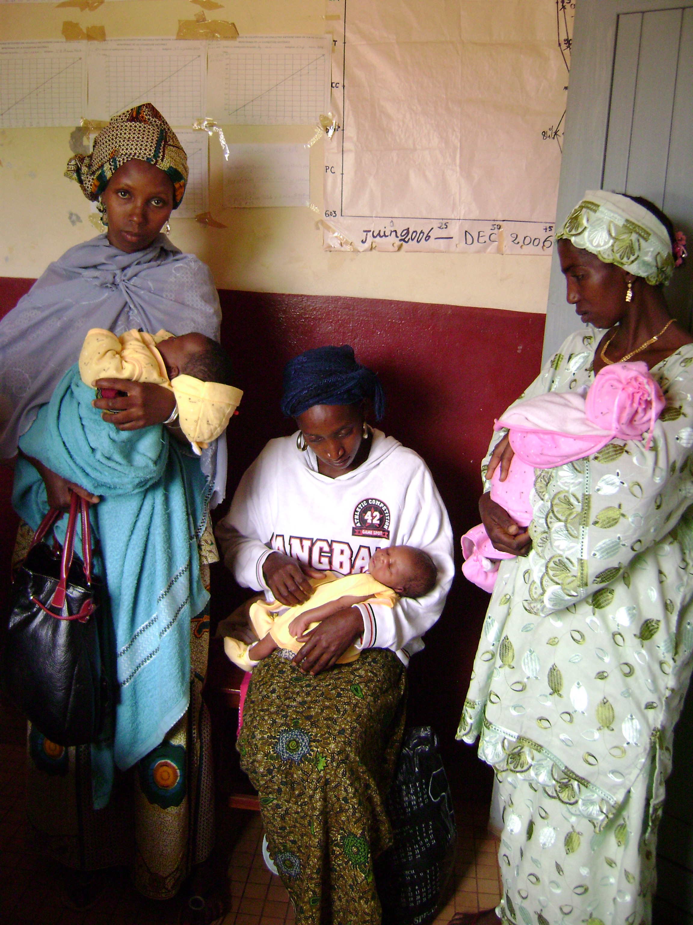 Women who have come to a health clinic to have their infants weighed. Labe, Guinea. October 2007.