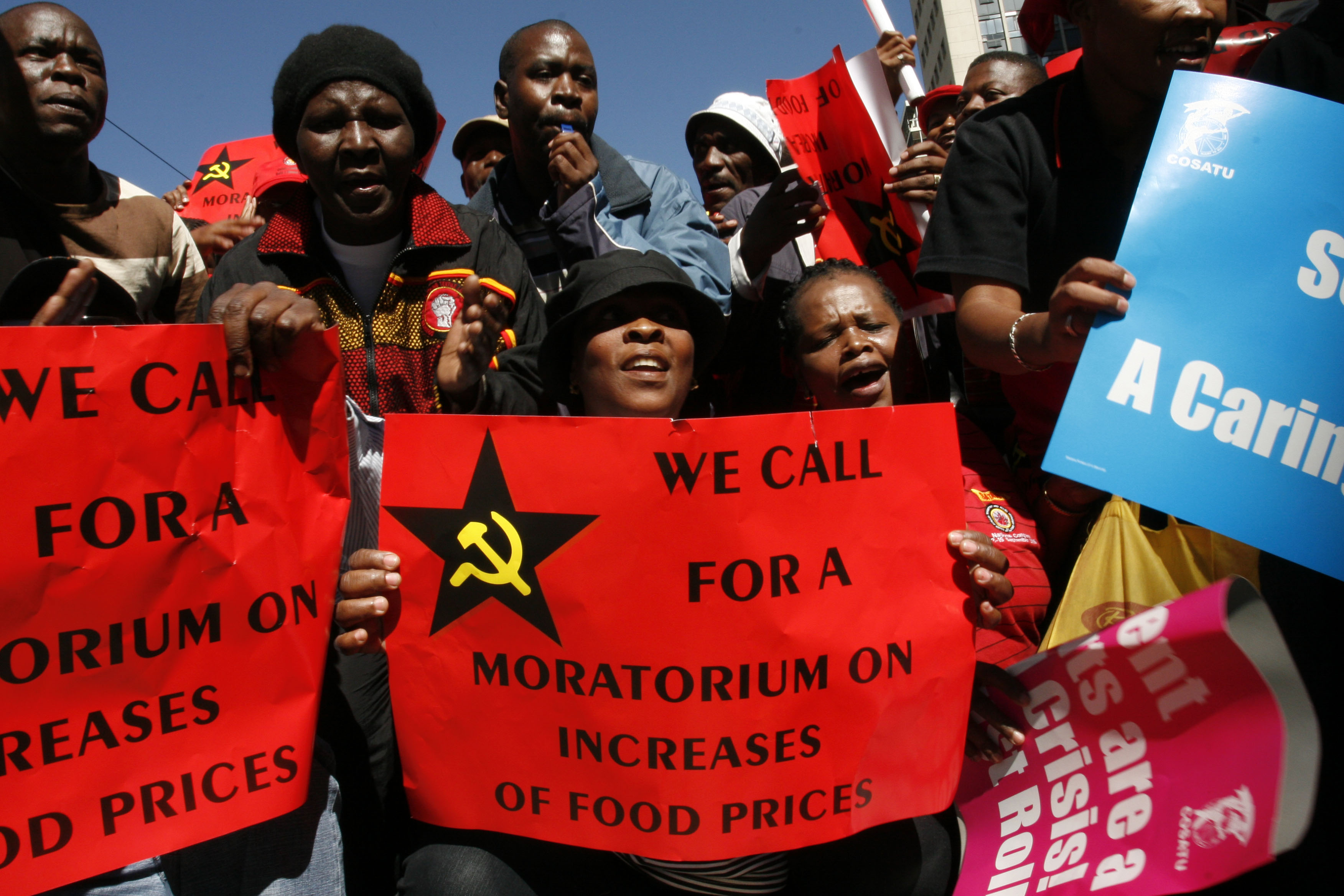 COSATU members demonstrate against spiraling food and electricity prices