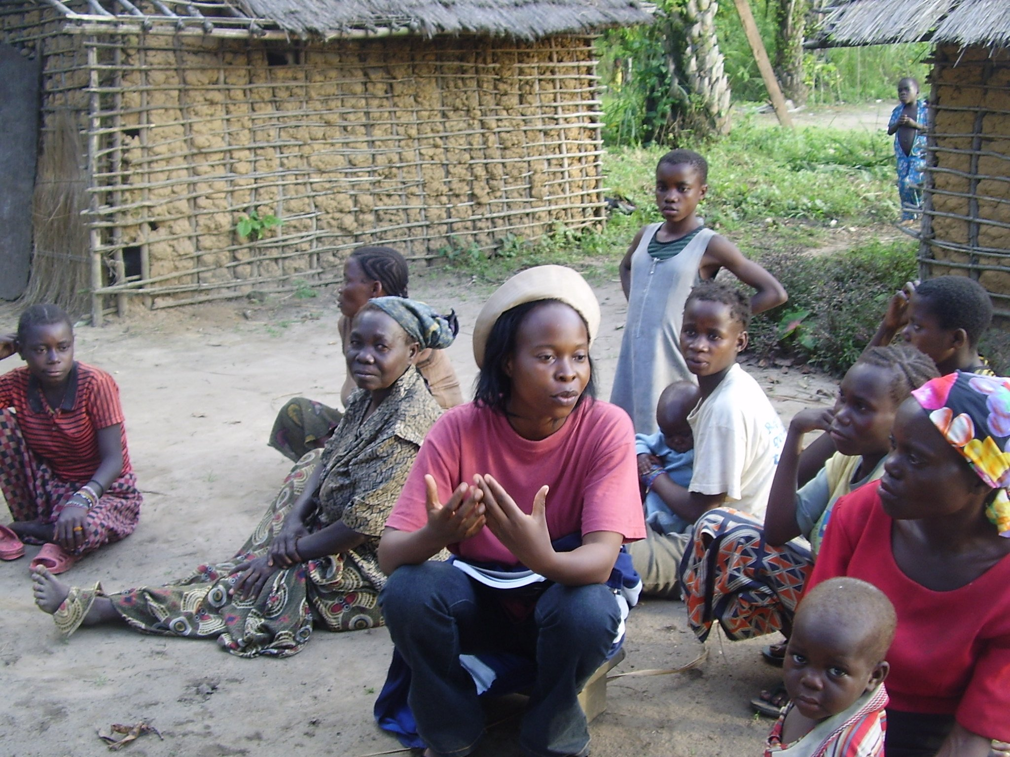 Baka Women and children in a village in Plateaux district discussing an NGO project, Congo, March 2008.