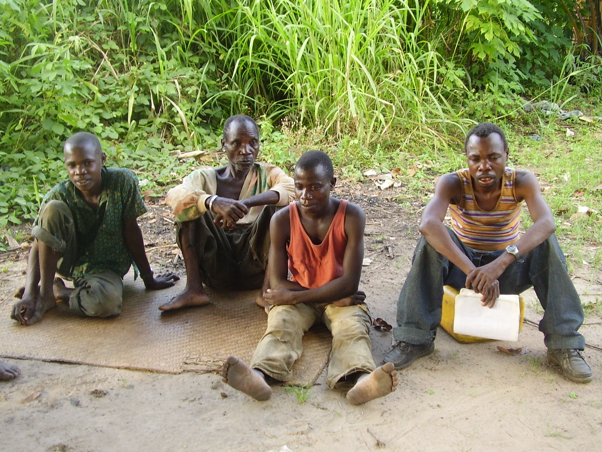 Young Baka men resting after a day of working on a project in a village in Gamboma district, Congo, March 2008.