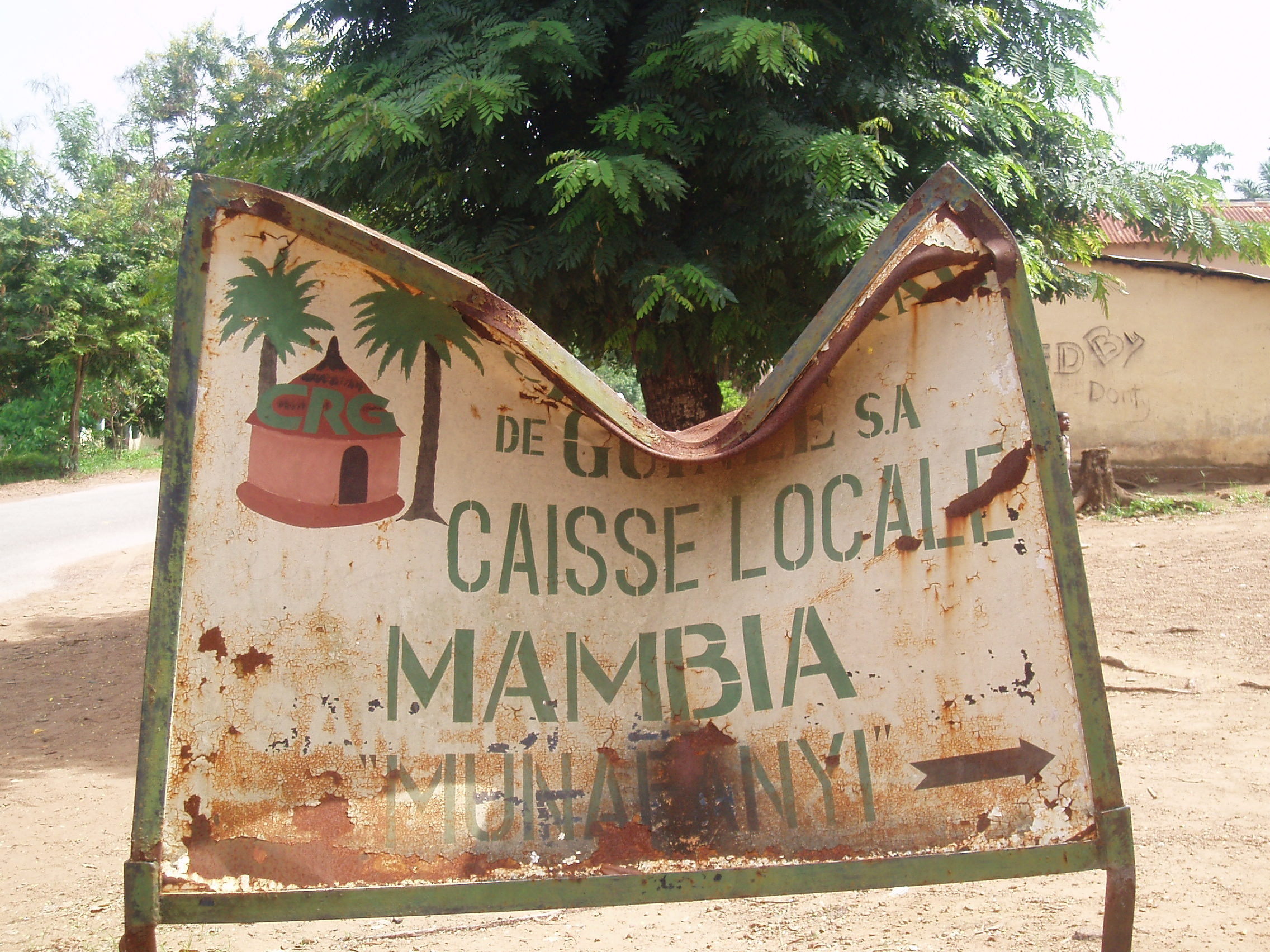 A sign at the entrnace to the village of Mambia, home to the Compagnies des Bauxites de Kindia's bauxite extraction mine.