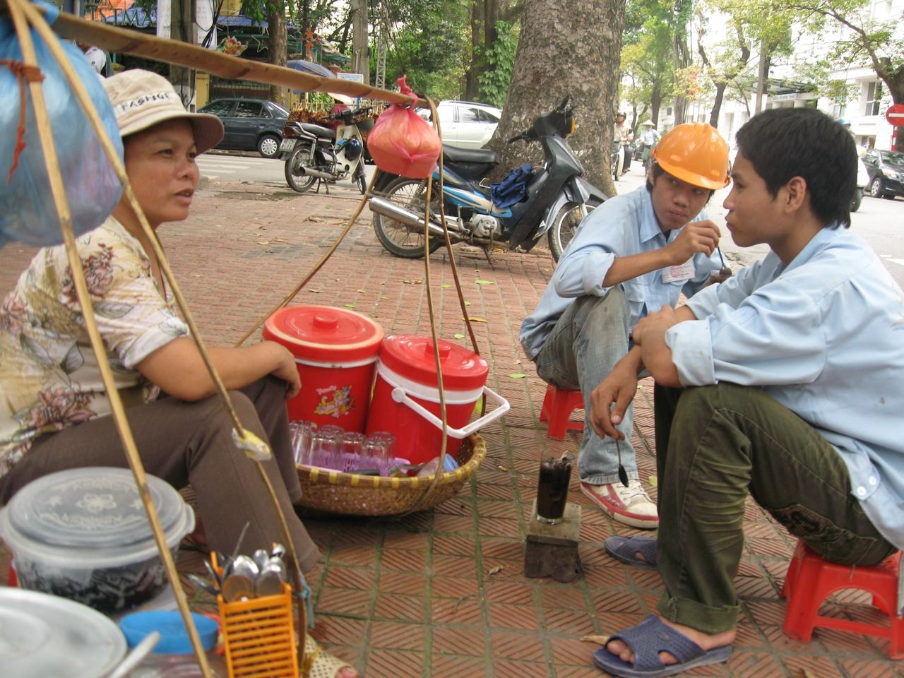 Workers pause for 'Thach', a popular Vietnamese iced drink that has doubled in price.