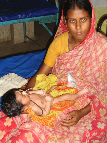 A mother tends to her baby at a hospital in Bangladesh's northern Siraganj District. Maternal mortality rates in the impoverished nation remain poor and the worst in South Asia.