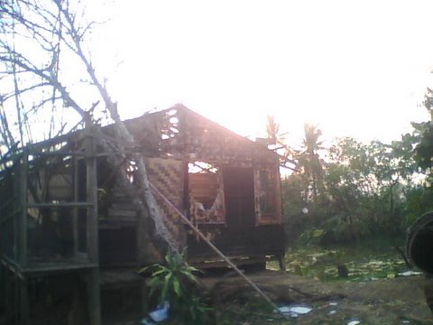 The home of Corina Samuel on the outskirts of the former Burmese capital, Yangon, was devastated by Cyclone Nargis, which ravaged much of southern Myanmar on 2 and 3 May, 2008.