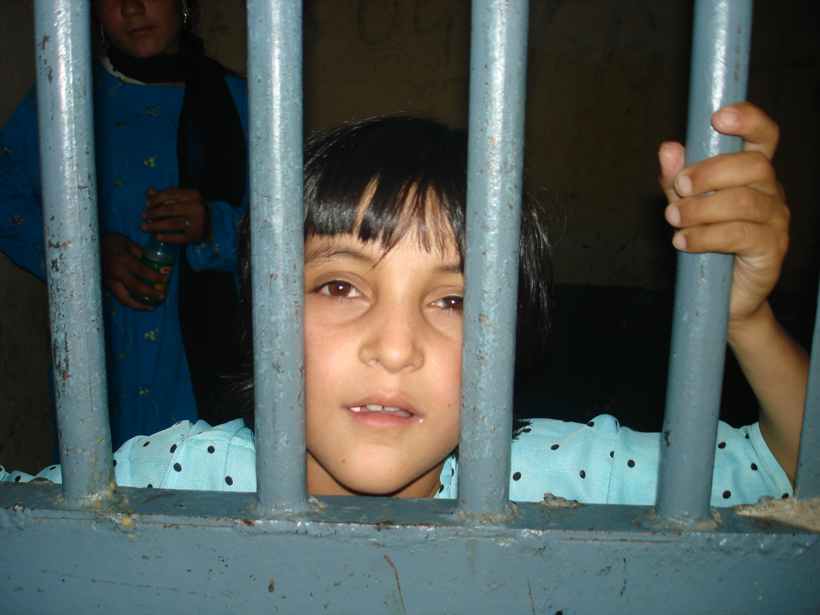 An Afghan girl living with her imprisoned mother in the Pul-e Charkhi prison in Kabul in 2007. More than 48 percent of children in detention said they were tortured, according to AIHRC.