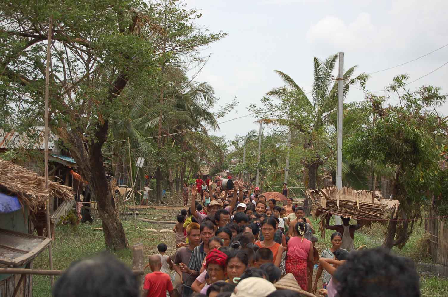 Survivors of Cyclone Nargis line up in Yangon to receive rice provide by the Moegyo Humanitarian Foundation in early May.