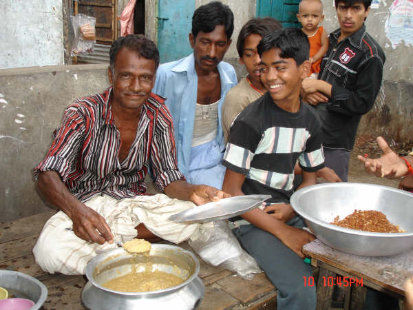 Sikander Ali sells porridge, earning just under US $2 a day to support the four members of his family. Most Biharis earn their livlihood from small businesses like this.