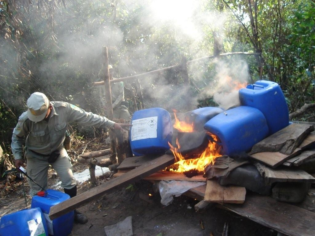 A seized distillery at Mreah Prew. The wood used to make sassafras is extremely rare and becoming extinct. Large numbers of other trees are being chopped down for fire-wood for the lengthy sassafras distillation process.