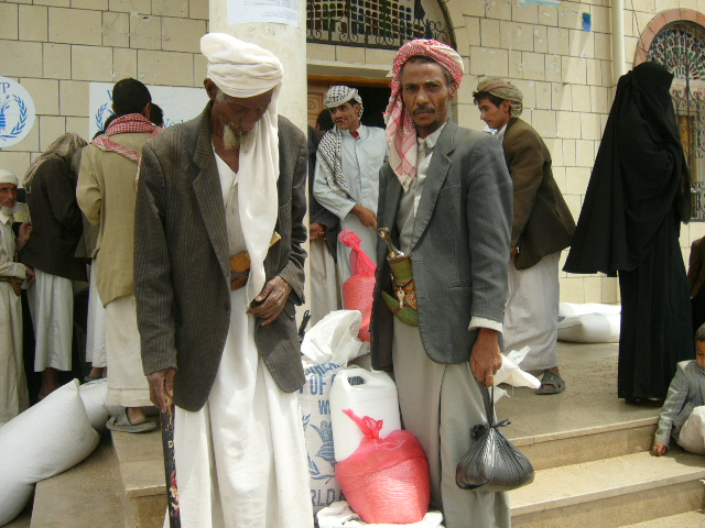 Displaced people in Saada province with food aid from the World Food Programme.