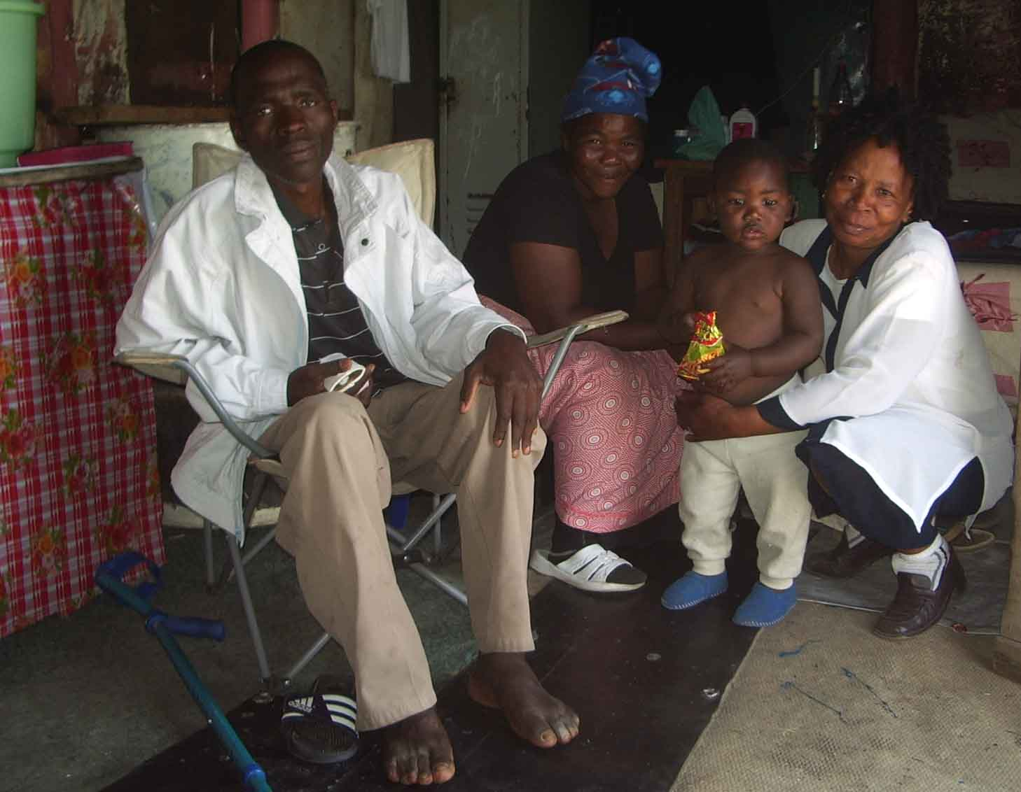 Home-based care-giver, Margaret Ndinisa visiting one of her patients and his family in Freedom Park, an informal settlement near Rustenberg.