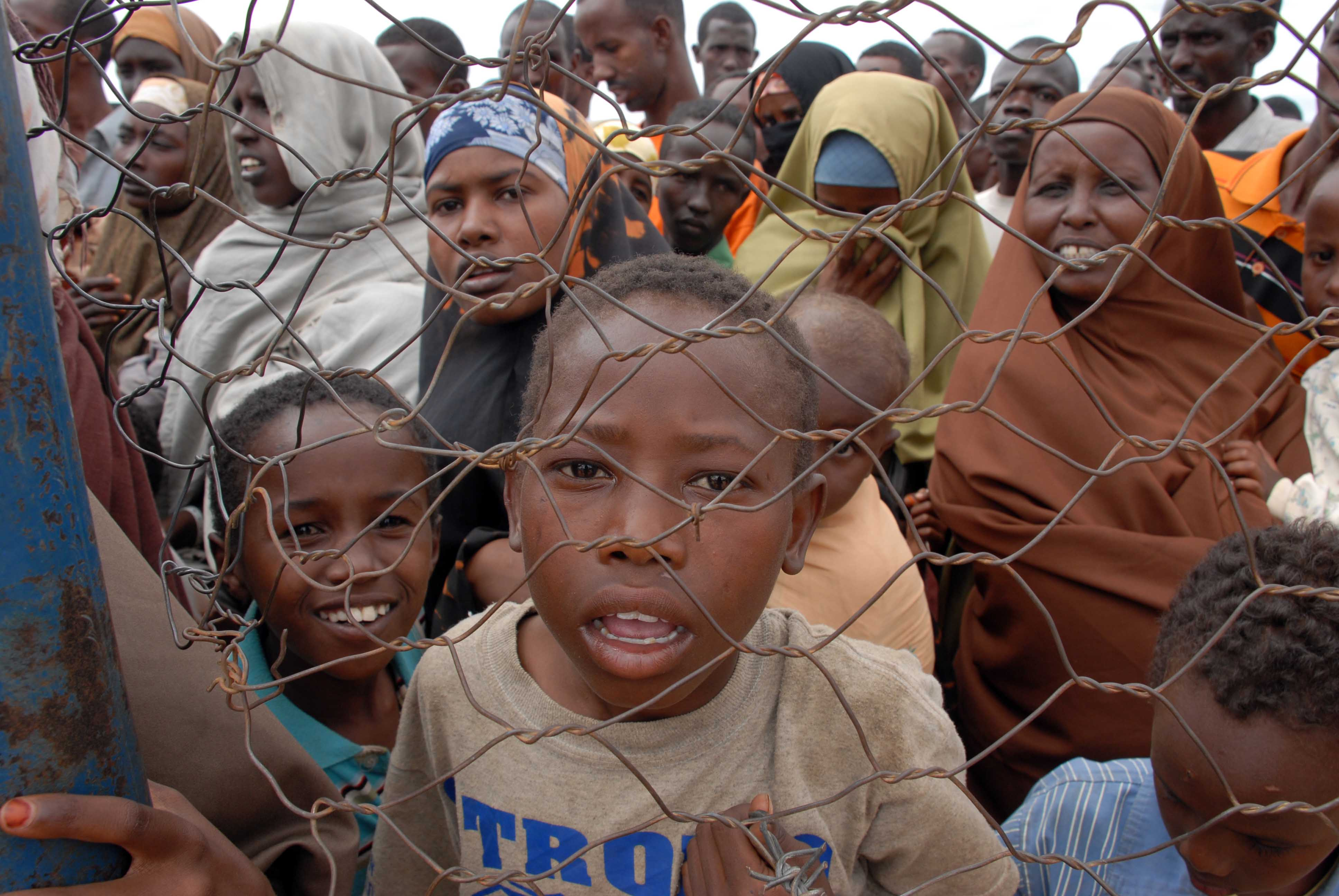 Refugees are controlled as they get into the UNHCR Dadaab camp for registration, Garissa District, Kenya August 2008.