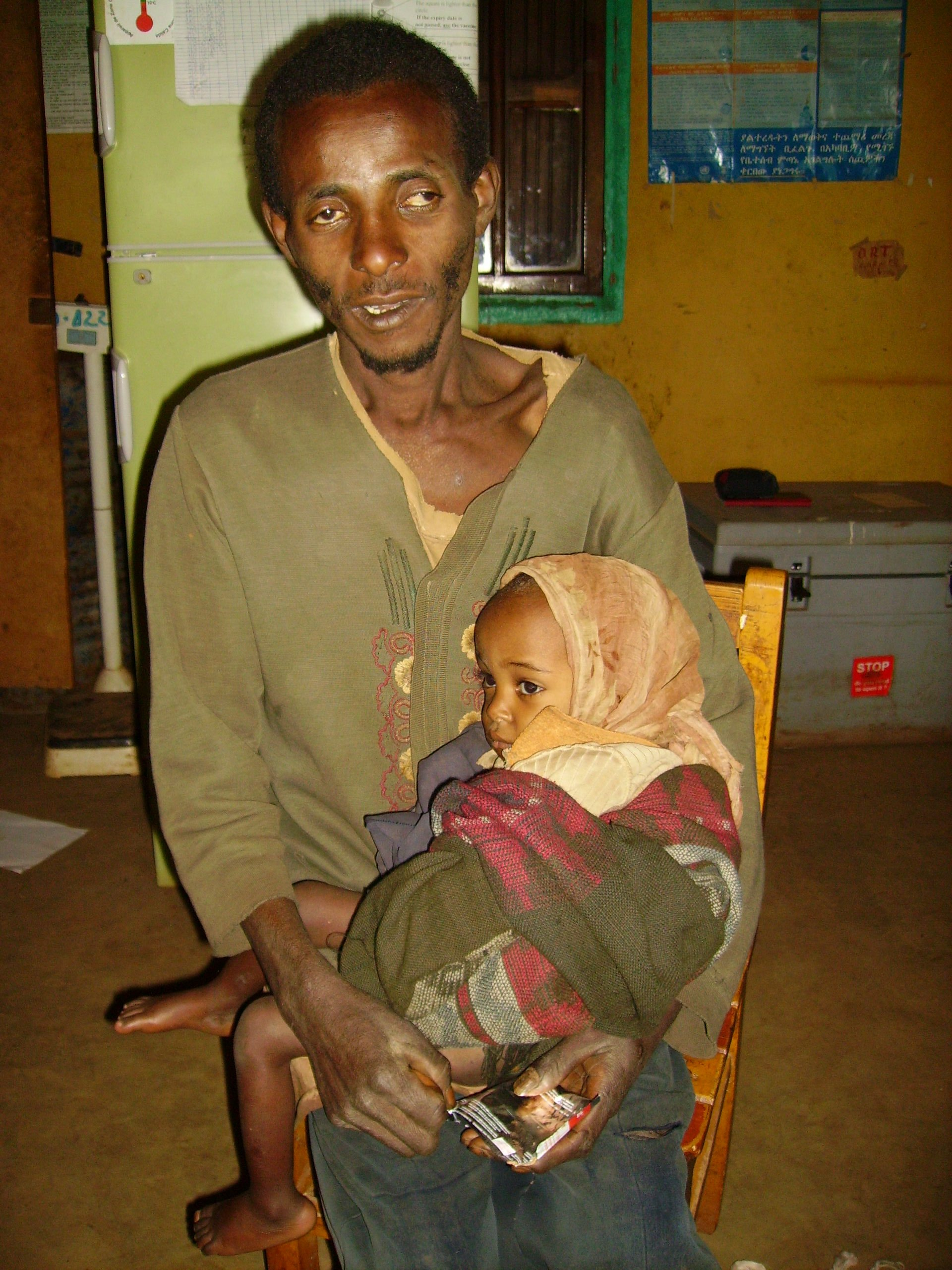 Yohannes Bate, 40, and his malnourished 3-year old son Miserach Yohannes awaiting treatment at Girara therapeutic feeding centre near Badessa, Wolayita district.