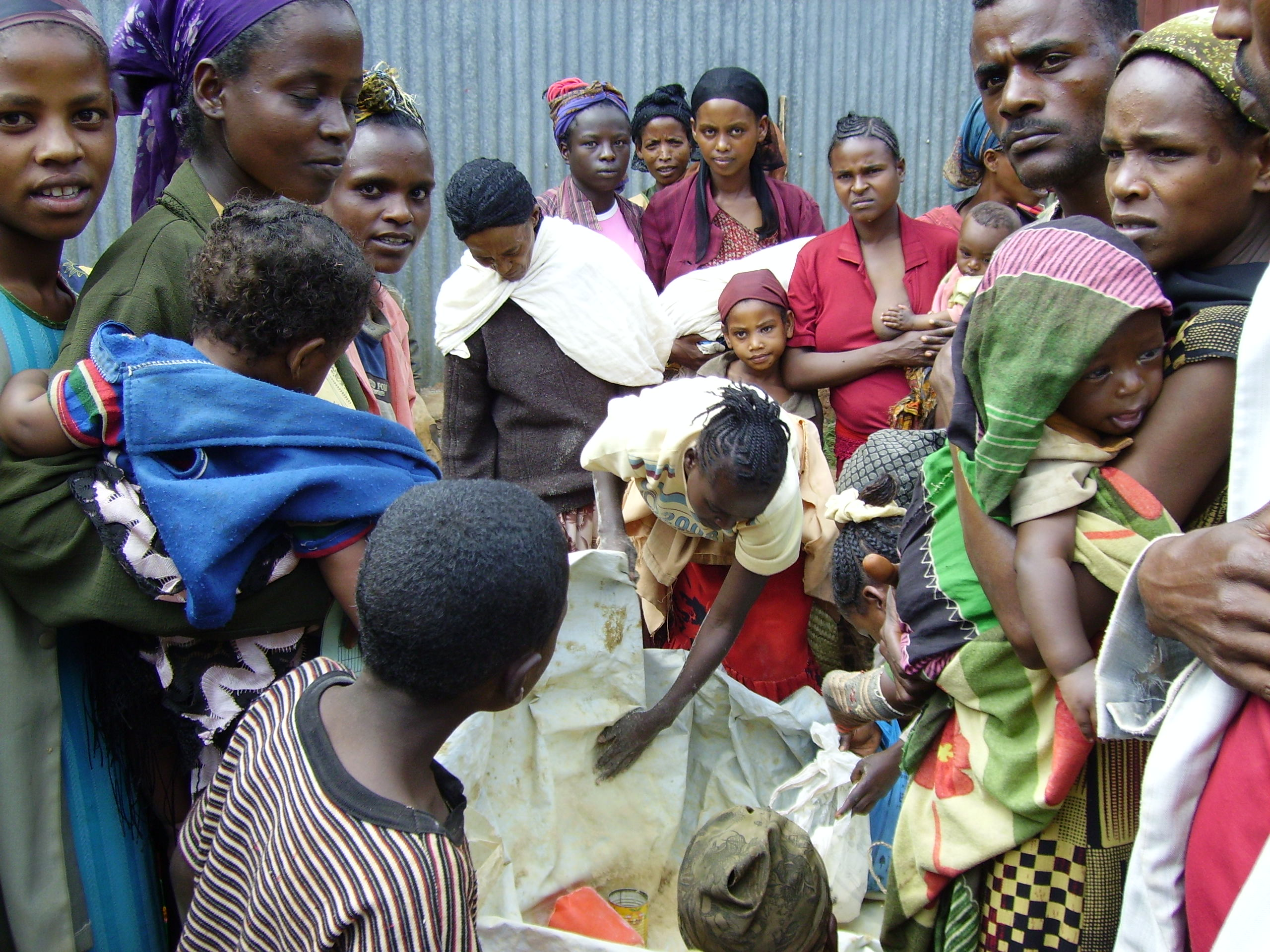 Recipients receiving supplementary foodstuffs distributed by Concern Worldwide in Badessa, Wolayita District of southern Ethiopia.