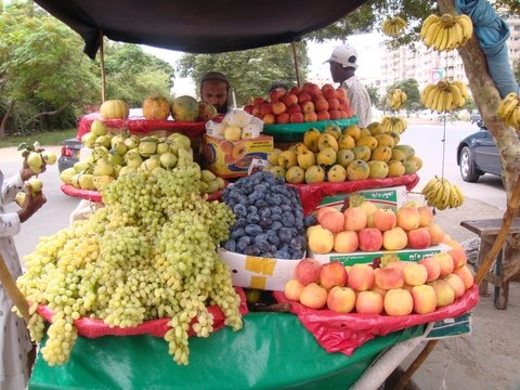 A cart laden with mouth watering fruit but few can buy.