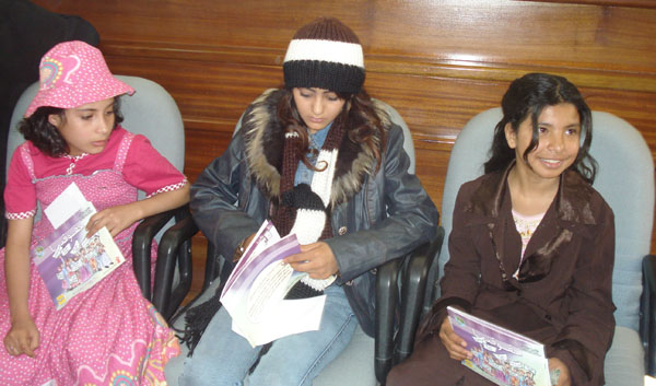 Three married young girls (aged eight, 12 and 10) during a public discussion by civil society organisations on child marriage.