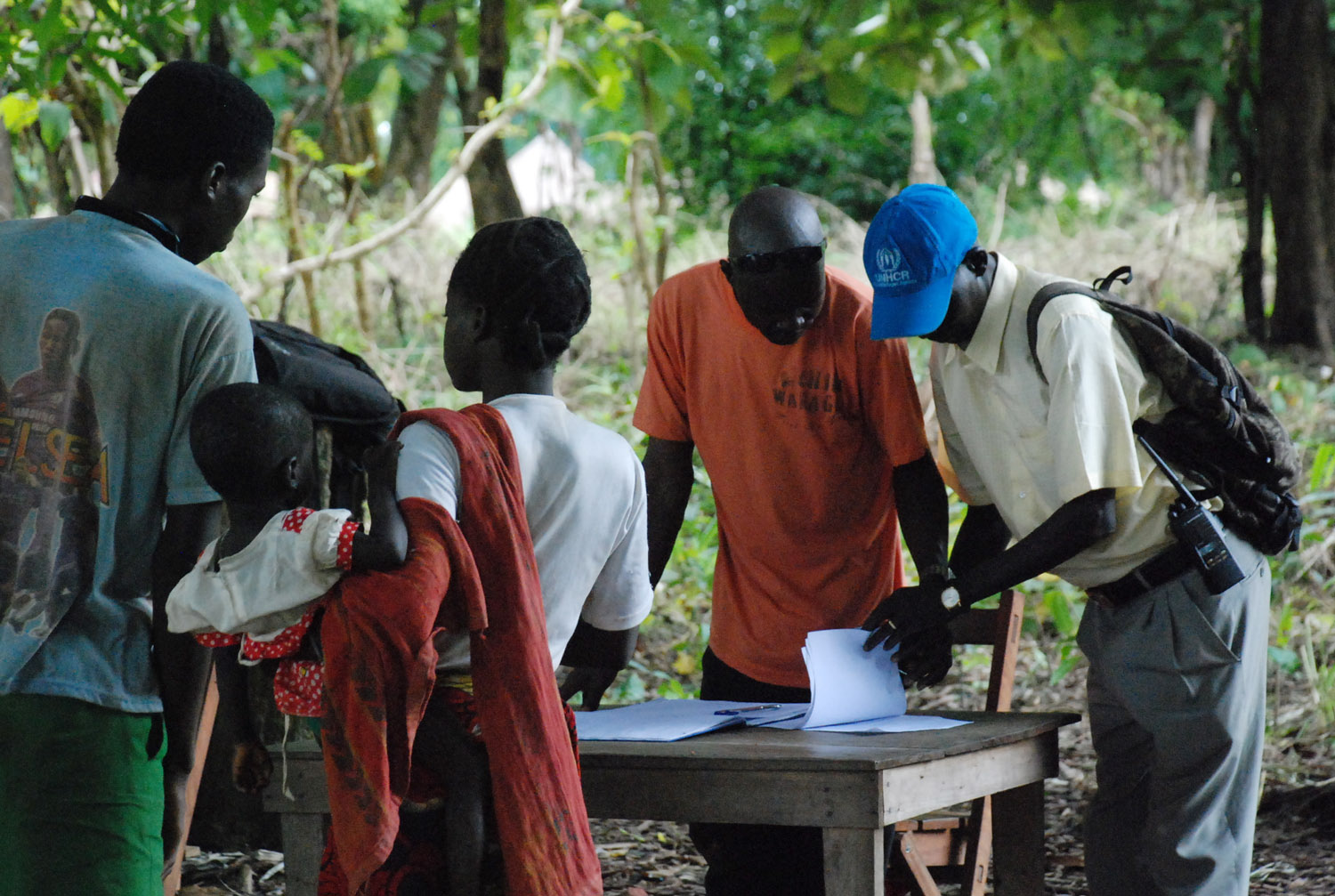 Refugees from the DR Congo fleeing LRA rebel attacks register with UNHCR officials at a forest clearing in the village of Gangura in southern Sudan.