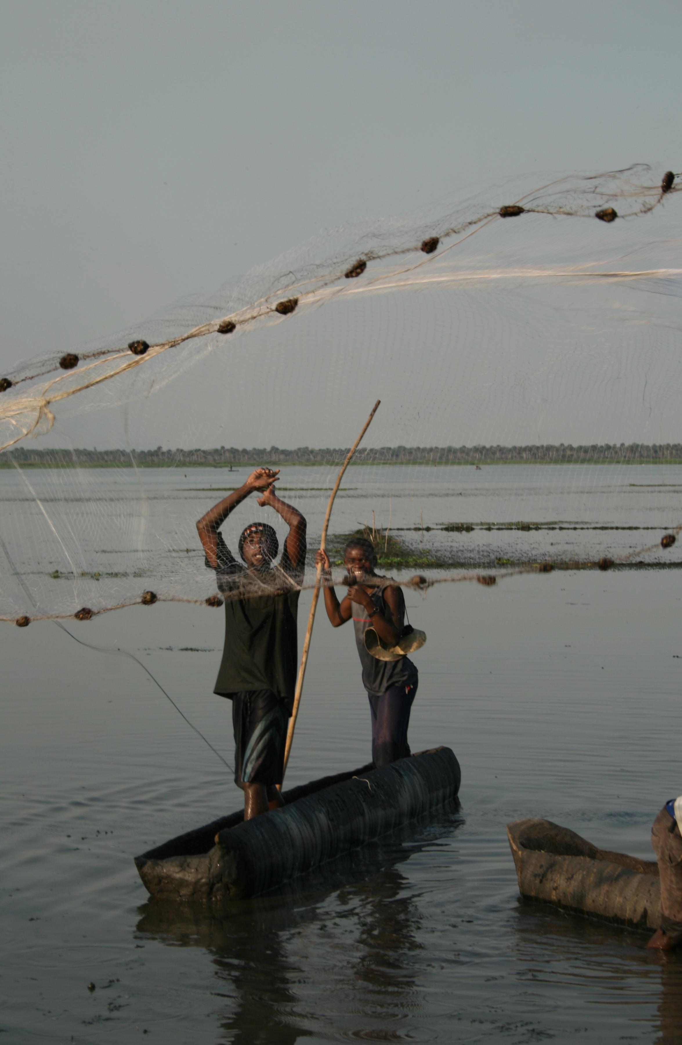 Fishermen near Mopeia in Mozambique's Zambezi river basin take a calculated risk by living next to the river. Flooding occurs almost annually now but fishing is their only way of making a living.