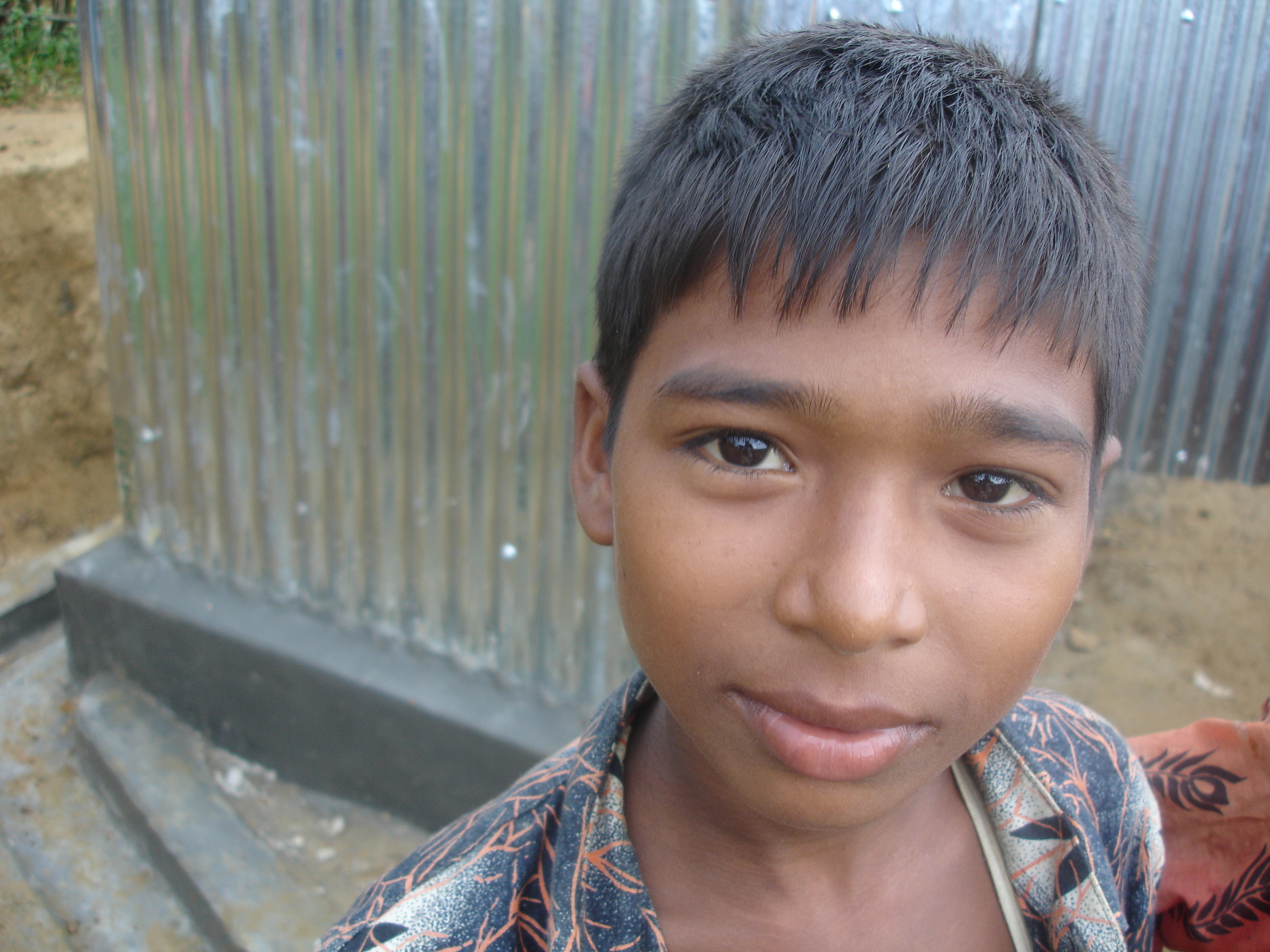 A Rohingya boy looks to the camera in southern Bangladesh. There are upwards of 200,000 Rohingya in the country, many of whom fled Myanmar in 1991.