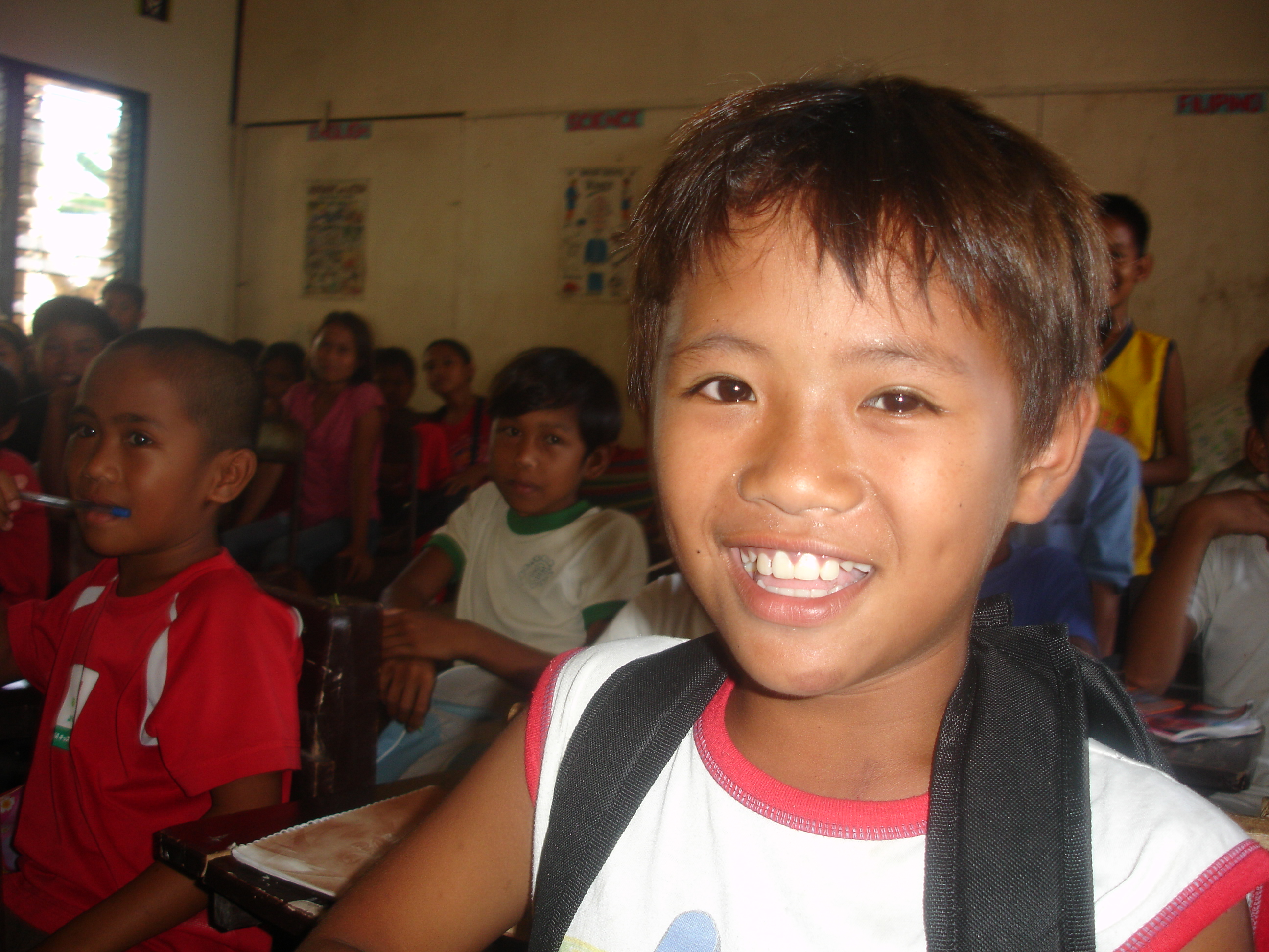 A young schoolboy at the Sambulawan elementary school in Mindanao. Thousands of children are not attending school regularly as a result of the conflict which reignited in August 2008.
