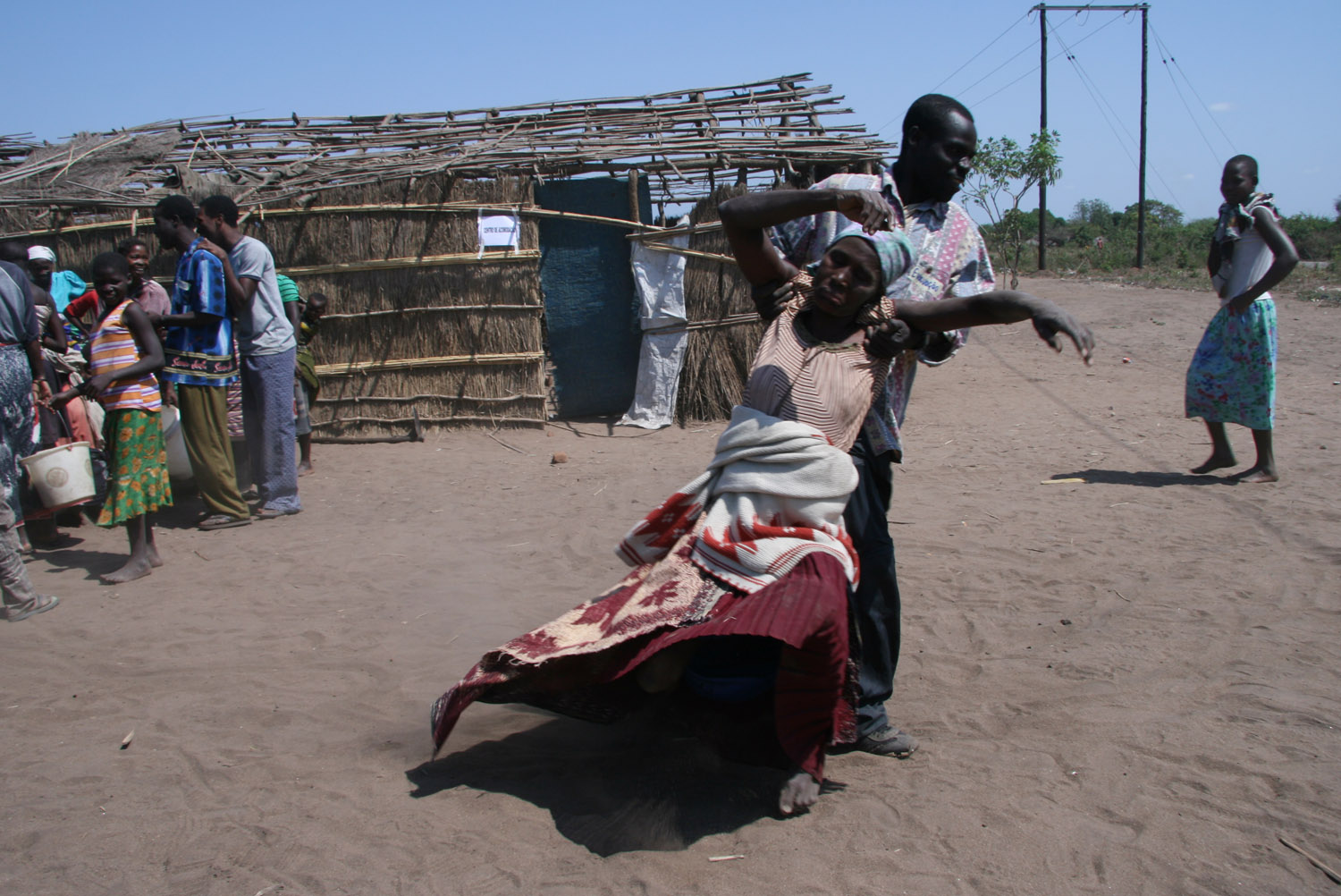 """Injured"" woman carried to safety as part of a flood simulation exercise designed to prepare people for emergencies. Floods have cost hundreds of lives and millions of dollars in damages in recent years in parts of Caia, Mozambique, 2008."