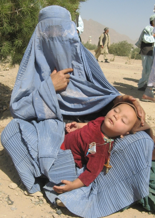 A beggar woman with a baby in Helmand Province.