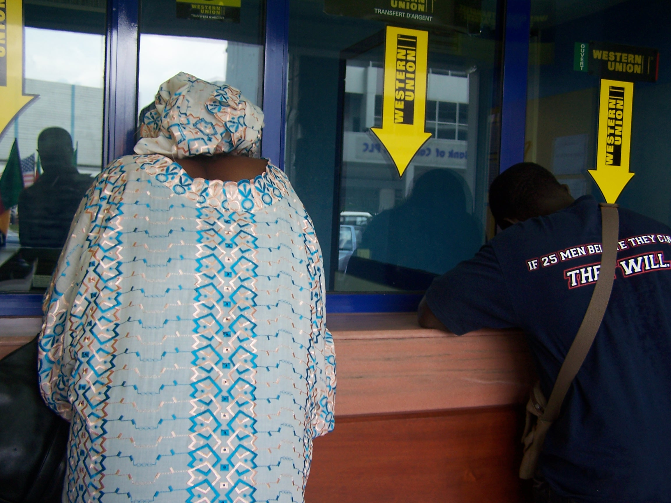 A woman picks up her remittances check in Cameroon.