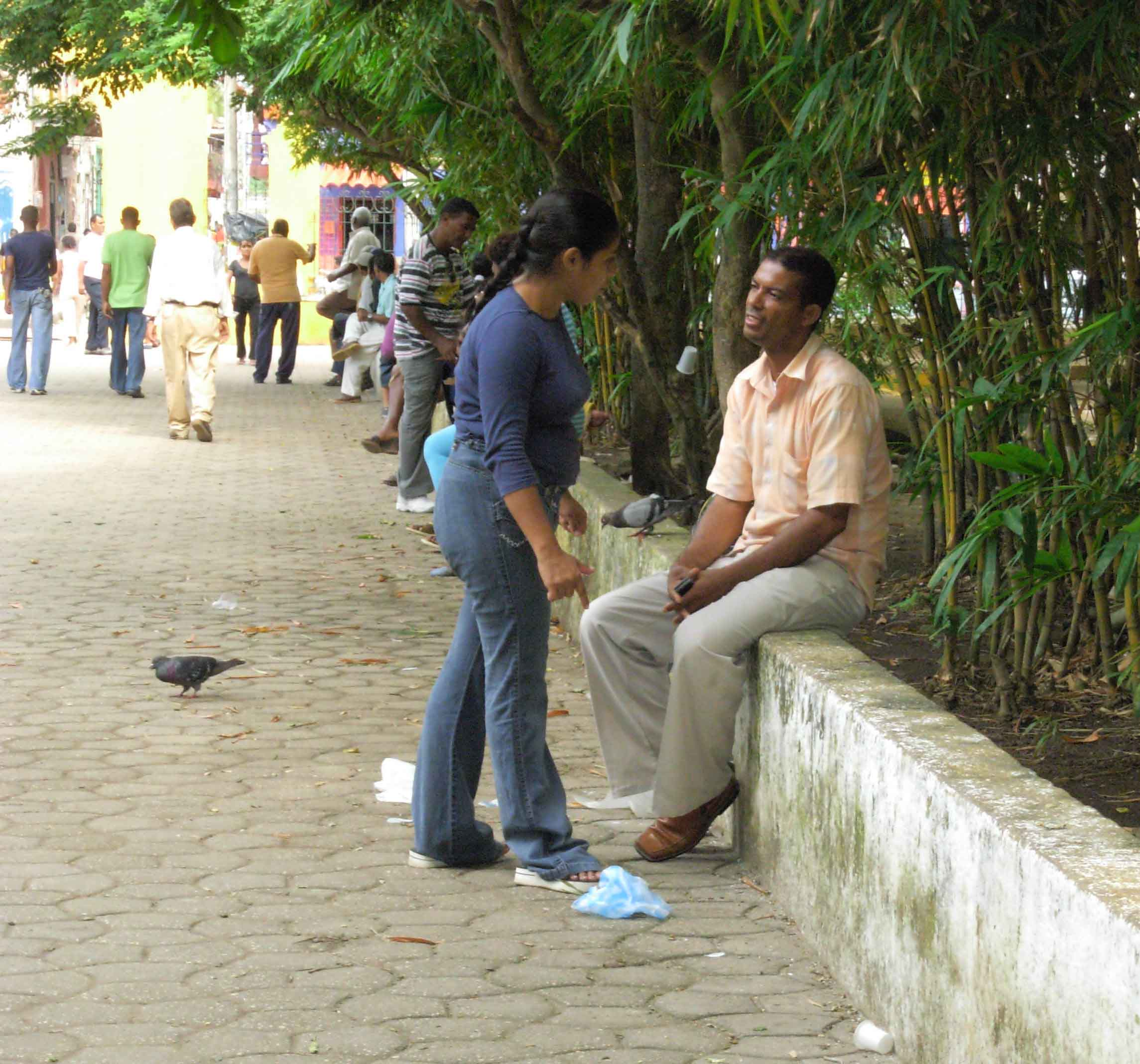 A couple in a park near Cartagena's red-light district