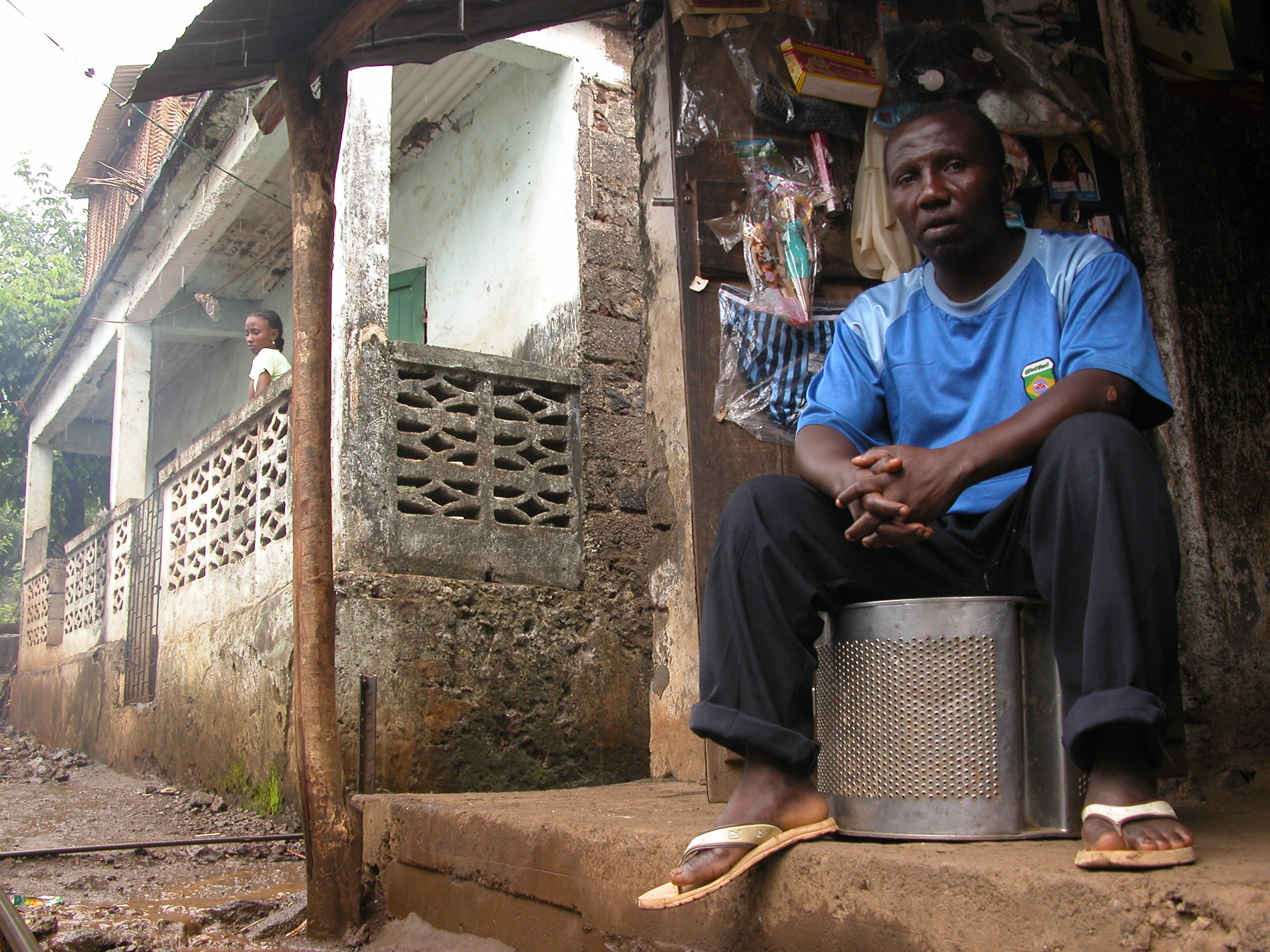 Laidine Abdullah sits outside his small shop in Barakani, a village in Anjouan