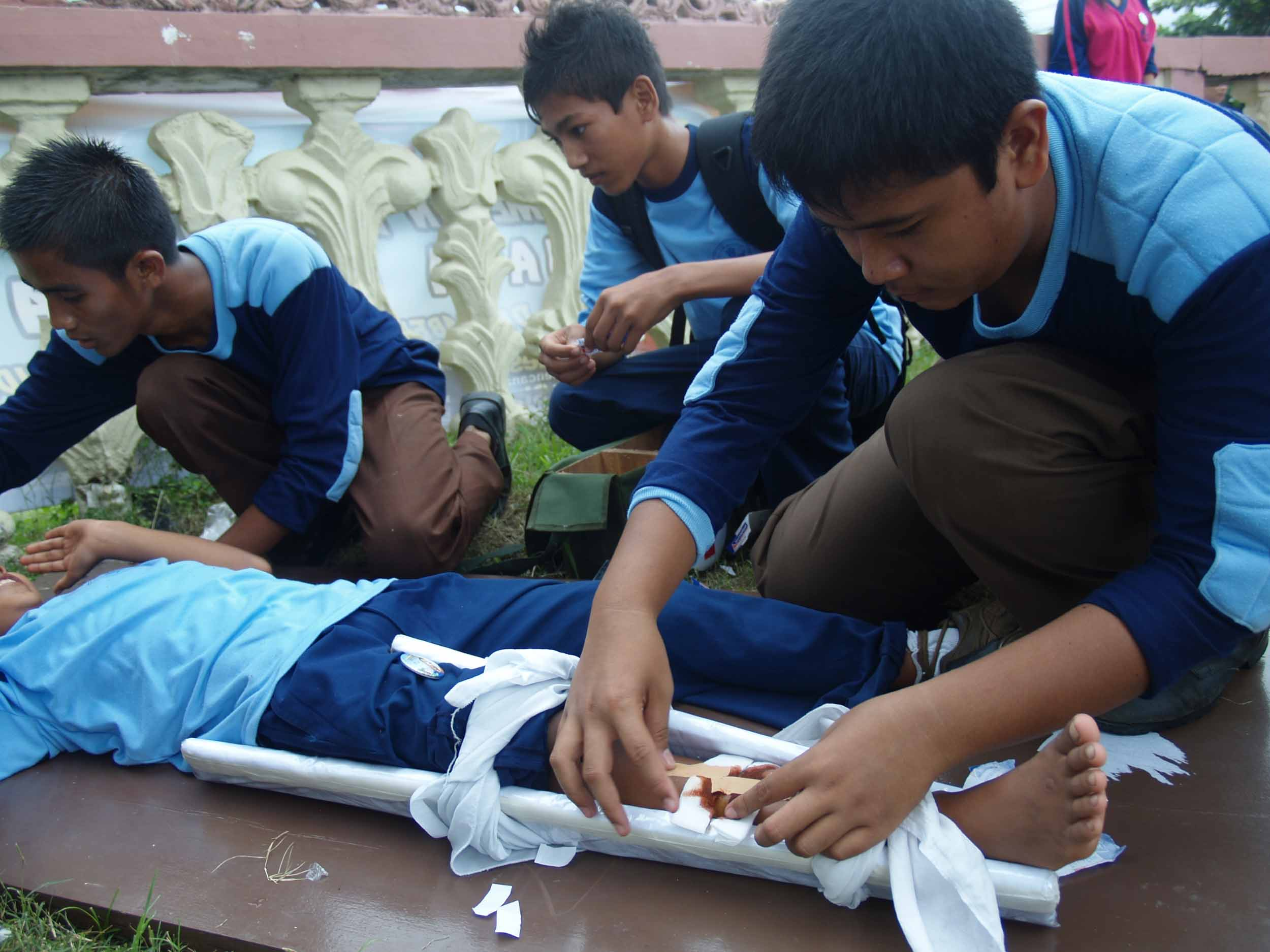 In Padang City, West Sumatra, Indonesia, students practice their first aid skills
