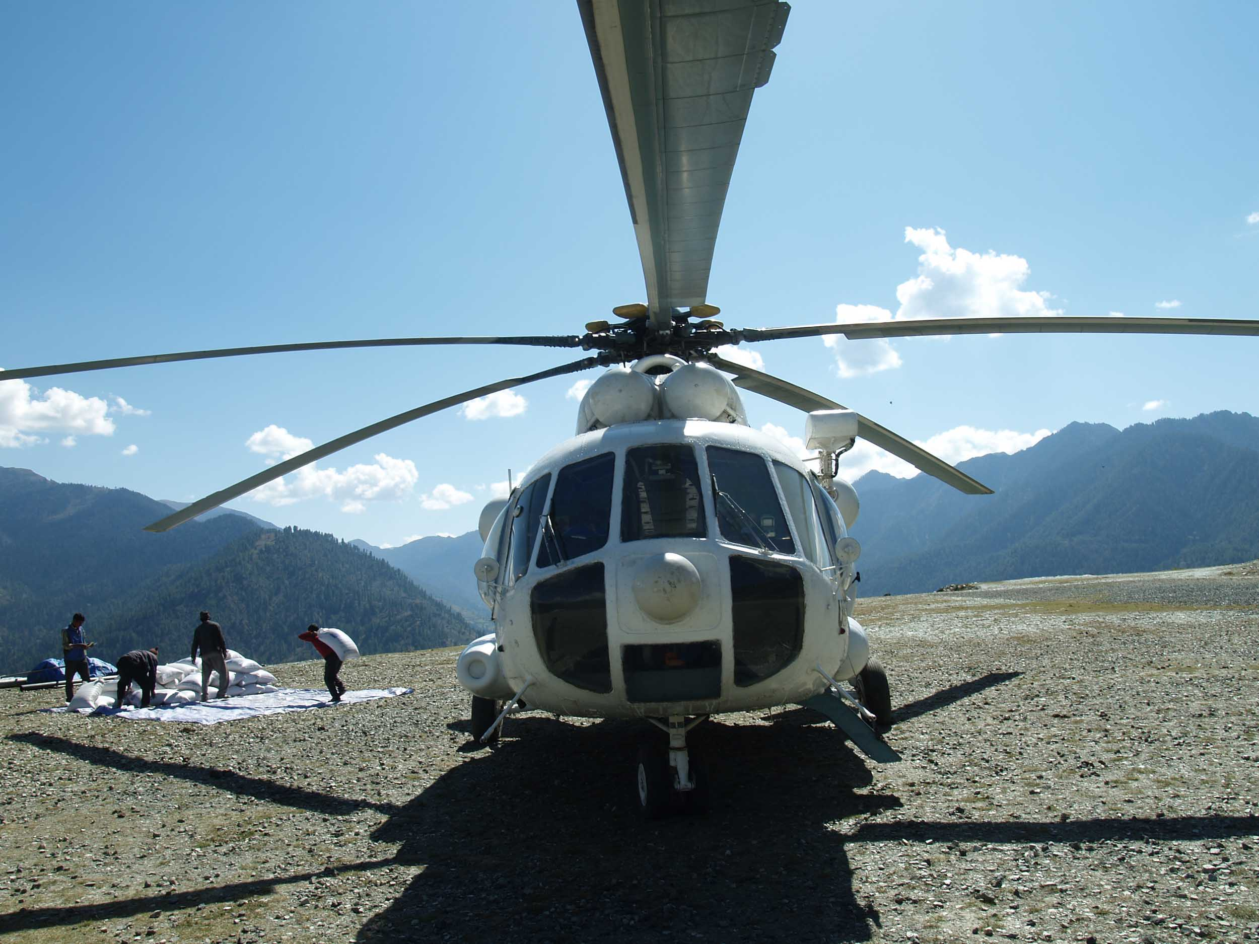 "A WFP helicopter delivers food in Pina for households who have worked on one of the 12 ""food for assets"" projects in the area supported by WFP, The Mountain Institute (TMI) and local NGO the Dolpa Institute"