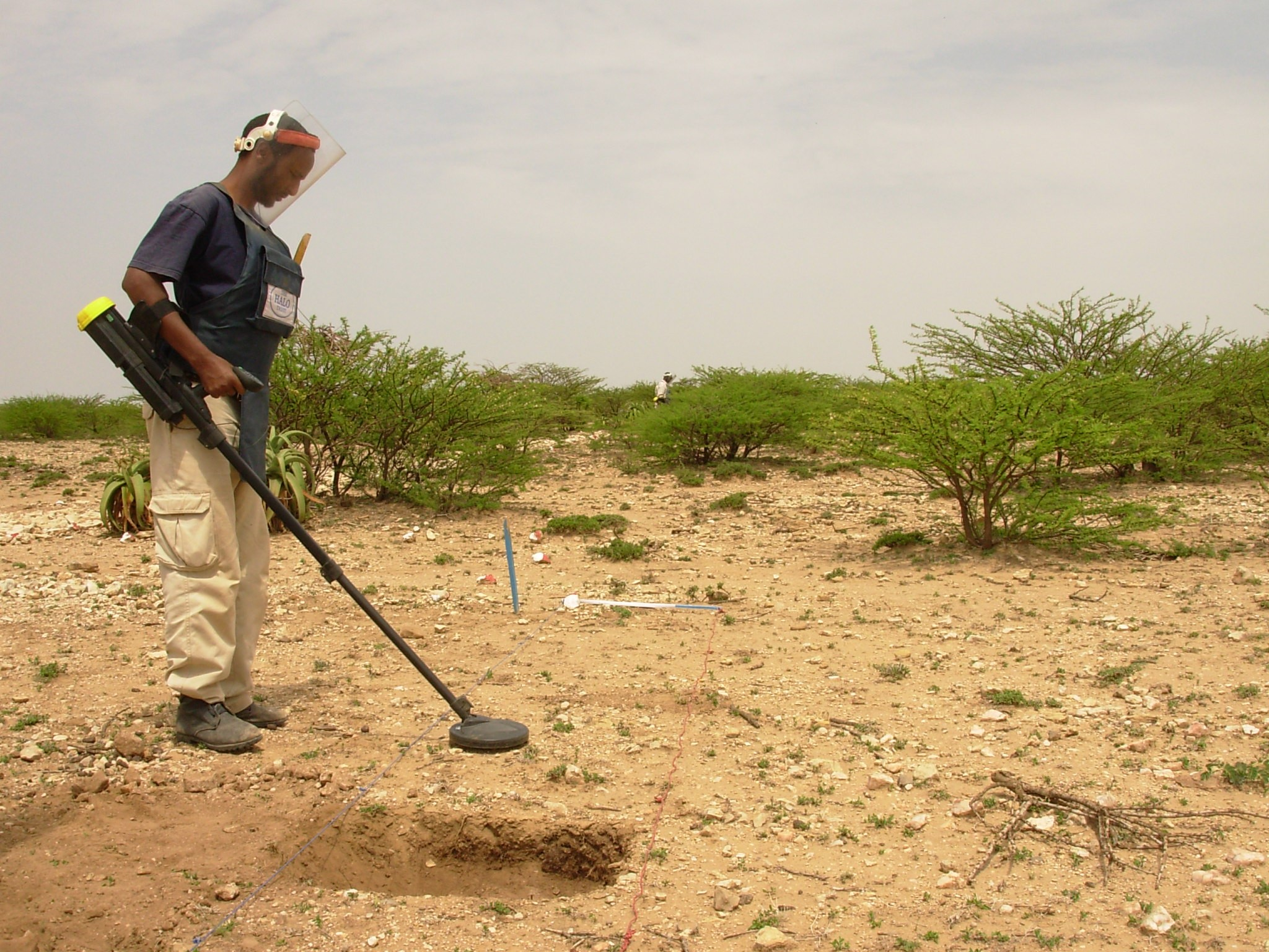 A de-mining official uses a metal detector to check for landmines in Somaliland