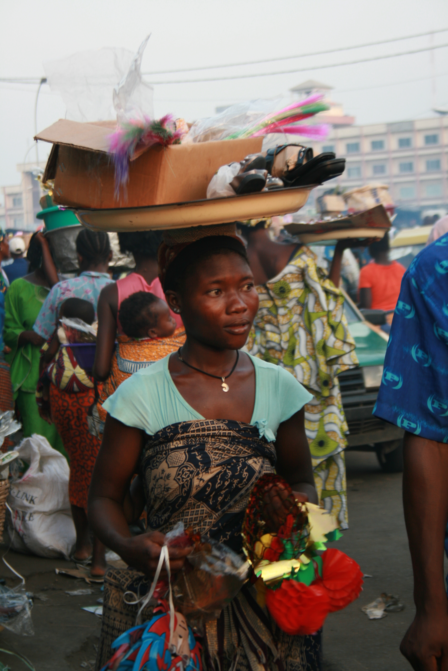Vendors crowd one another in Cotonou, Benin's Dantokpa market