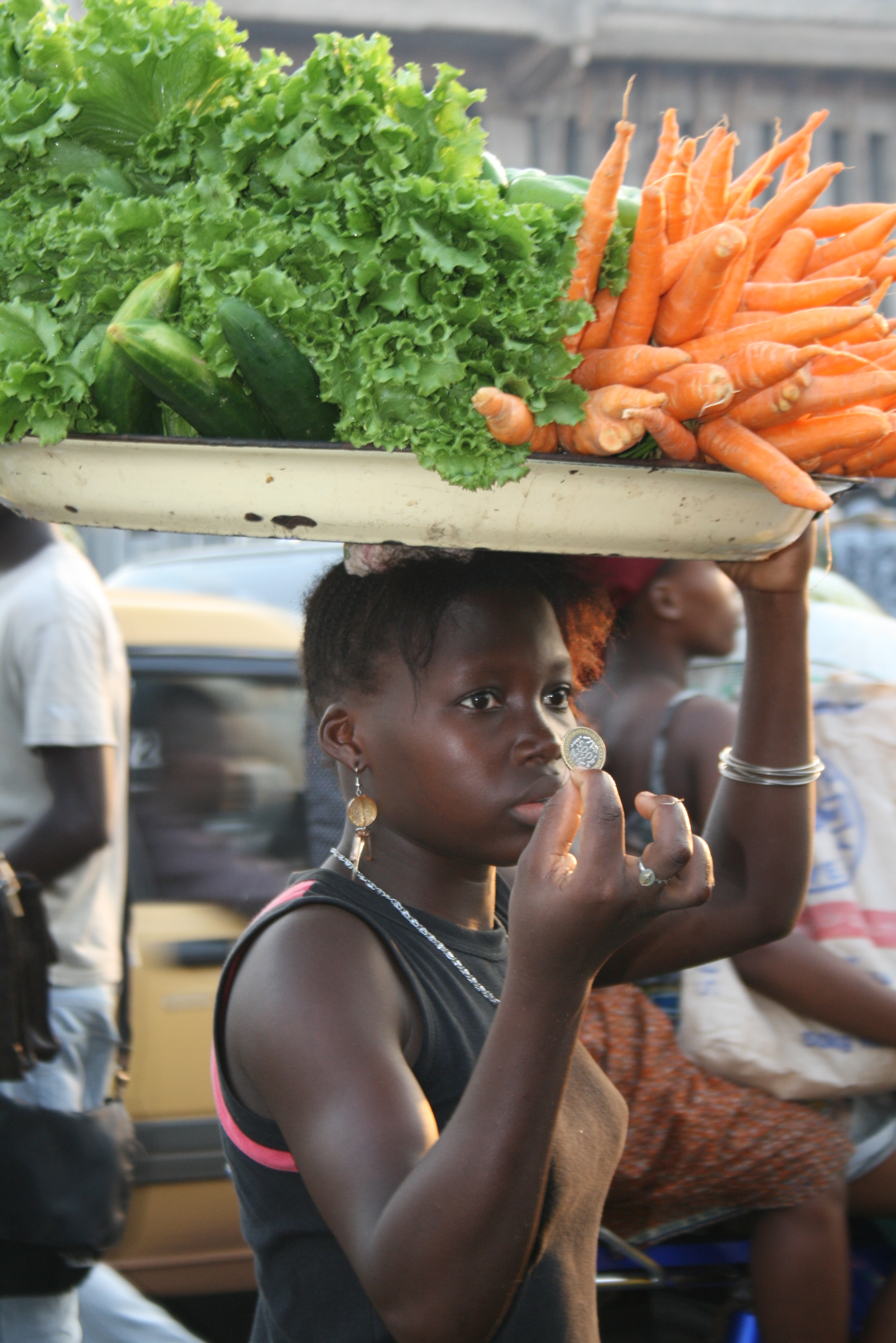Young girl in Benin's largest market in Cotonou. Whether she is an economic migrant or victim of trafficking is central to a regional mobility study of children's migration in West Africa