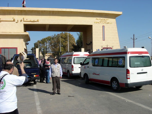 Ambulances line up on the Egyptian side of the Rafah border crossing with Gaza waiting to receive evacuated wounded Palestinians