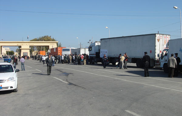 Trucks filled with medical supplies on the Egyptian side of the Rafah border crossing wait to go through