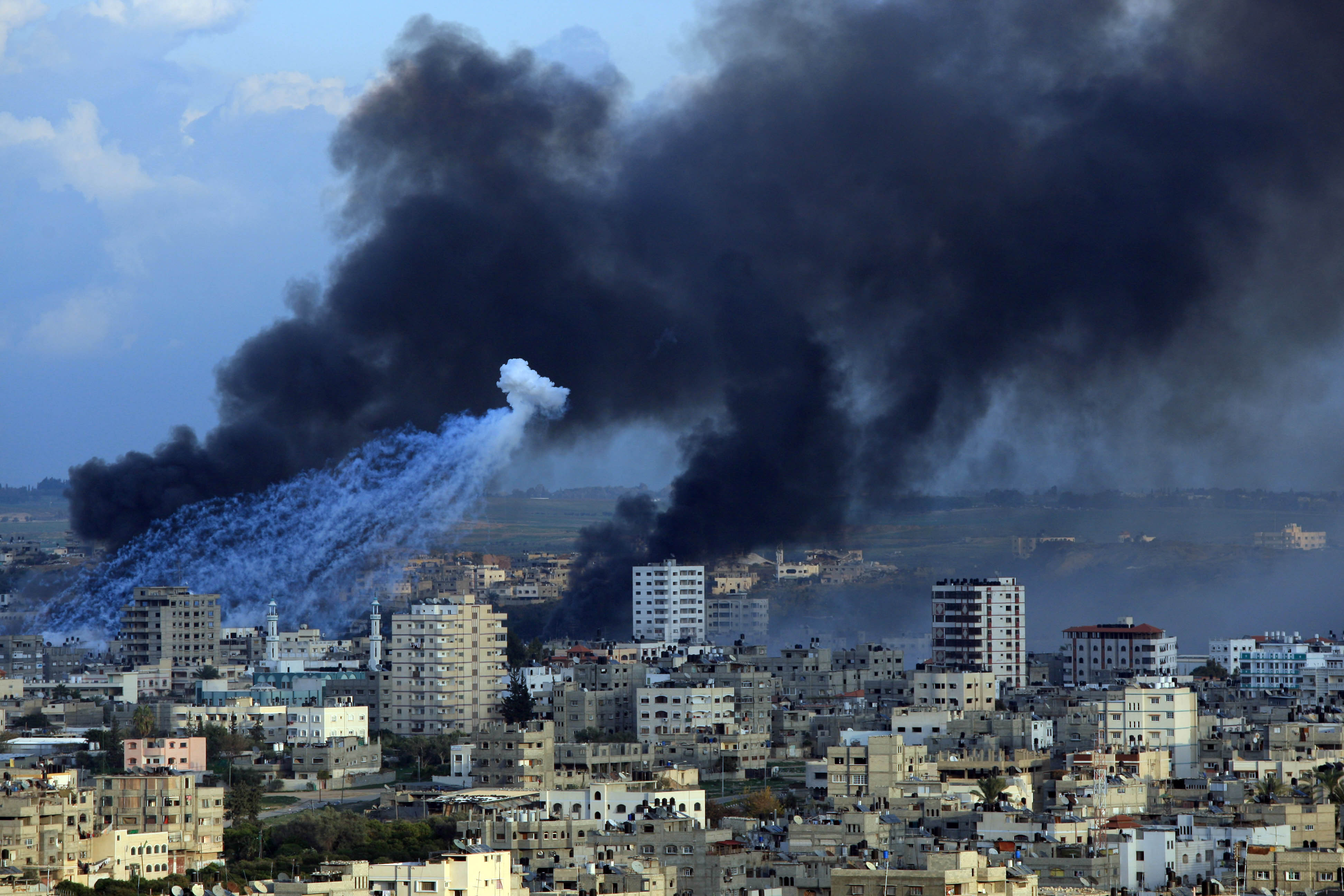 Fire and smoke billow following an Israeli airstrike in the southern Gaza Strip town of Rafah near the border with Egypt