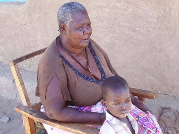 Jennifer Awuondo, 68, is a grandmother caring for her orphaned grandchildren in Nyando District, Nyanza Province, western Kenya. She lost her children to HIV-related illnesses, and one of her grandsons has recently become infected with the virus