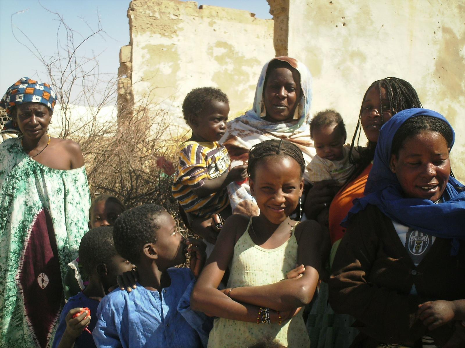 Returnee Benta Yoro Sow, second adult from left, outside her late father's home in Rosso, Mauritania