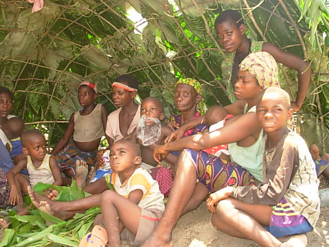 A group of indigenous people outside a hut in the forest of Impfondo. Impfondo is located at least 800 km north of the capital Brazzaville. Communities living in remote areas often lack access to social services such as healthcare are often left out in di