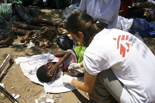An MSF aid worker treats a cholera patient in Beitbridge, Zimbabwe on the border with South Africa