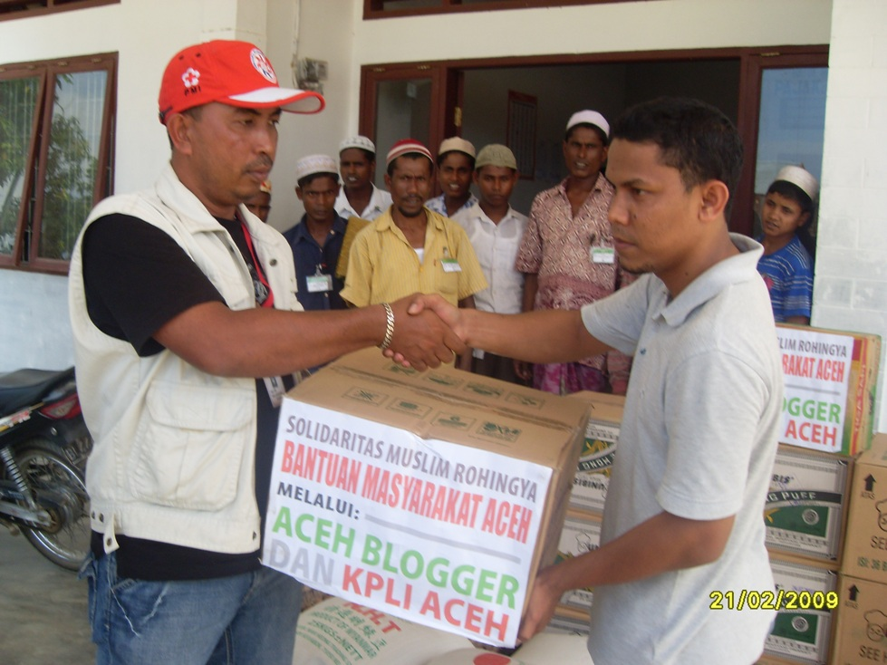 Rohingya refugees receiving assistance in Aceh, Indonesia