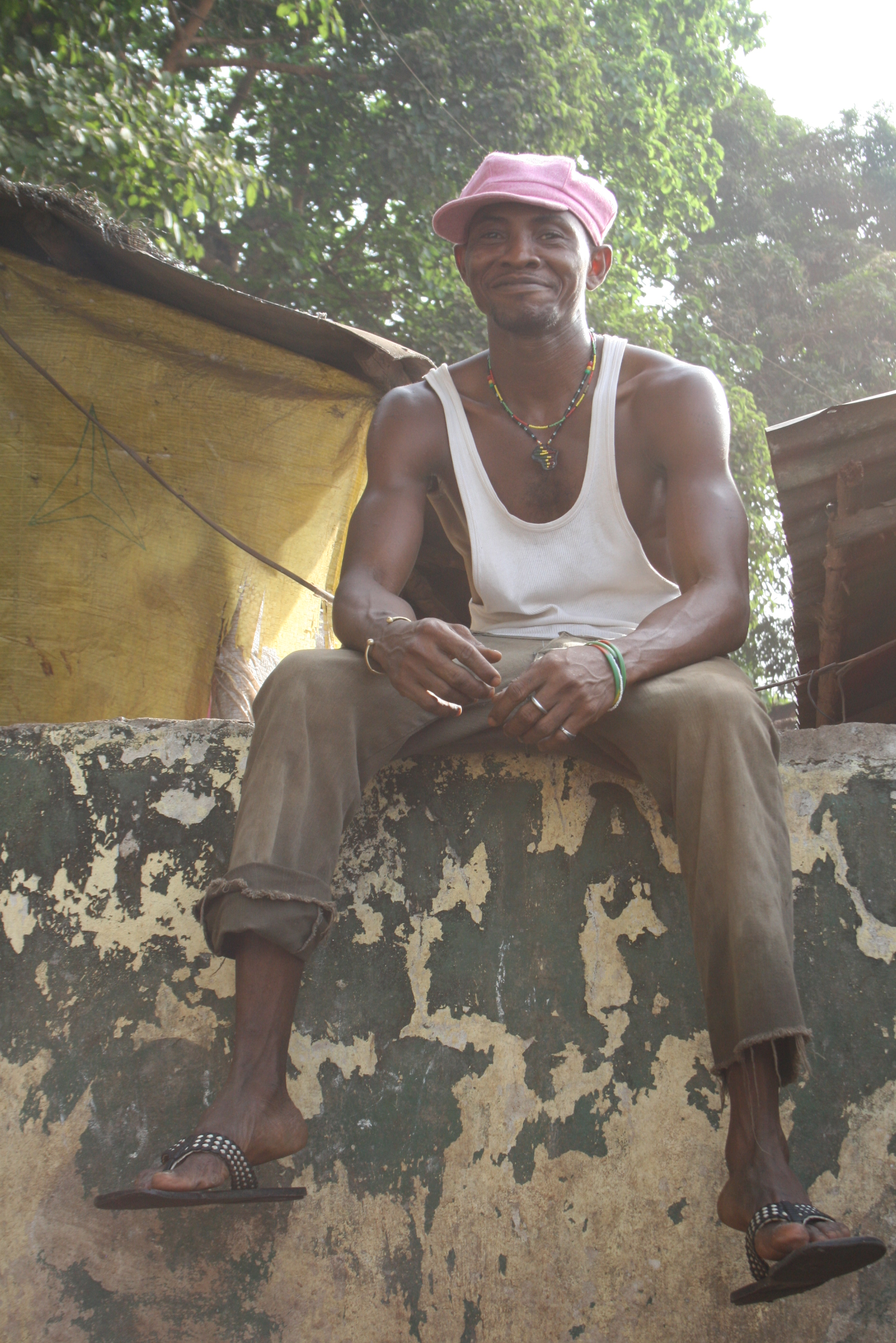 A member of the West Sie Boys, who set up and run a public shower in Kroo Bay slum, Freetown