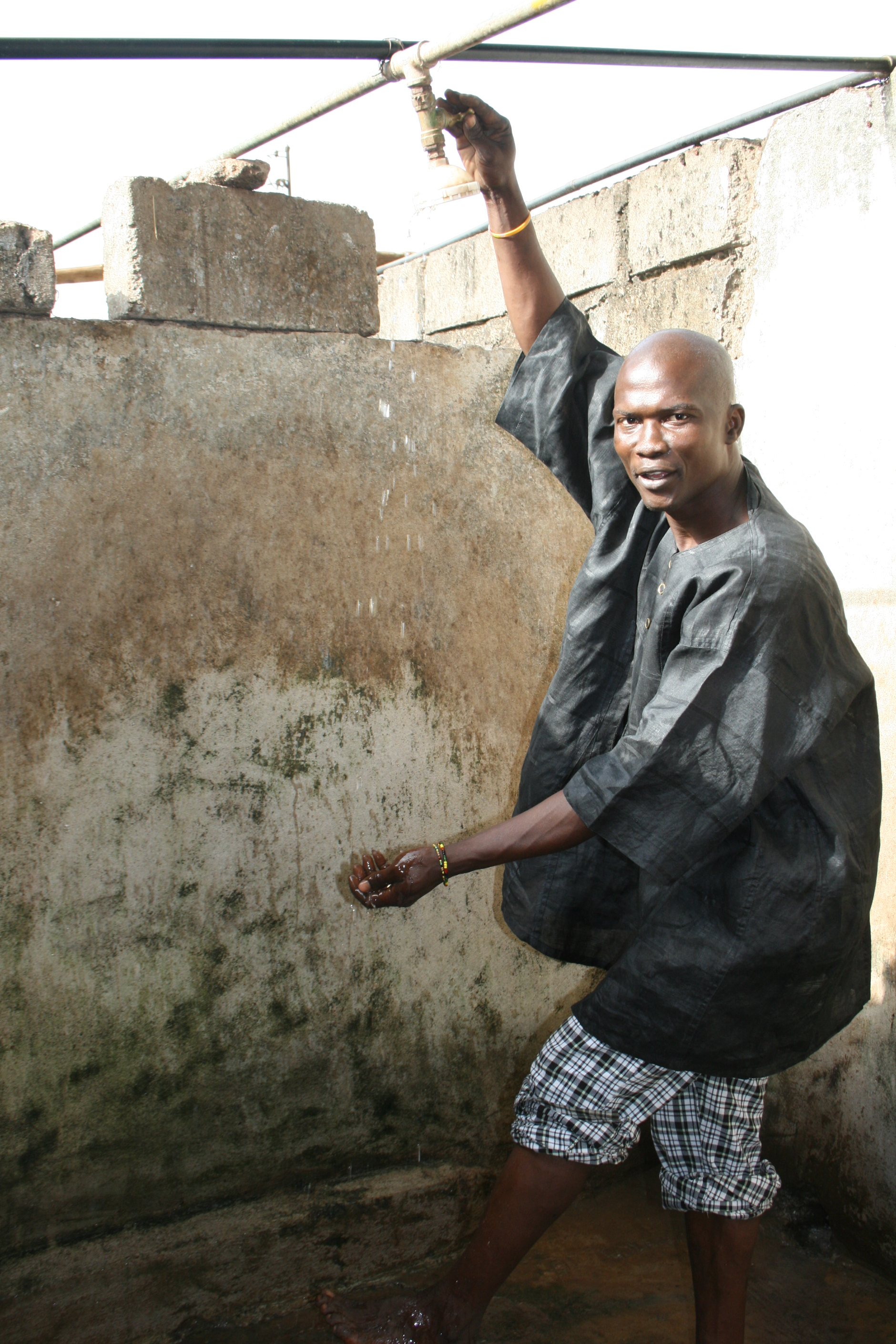 Sidiki Mansark runs the Water Sie Boys, a cooperative that set up public showers in Kroo Bay slum in Freetown
